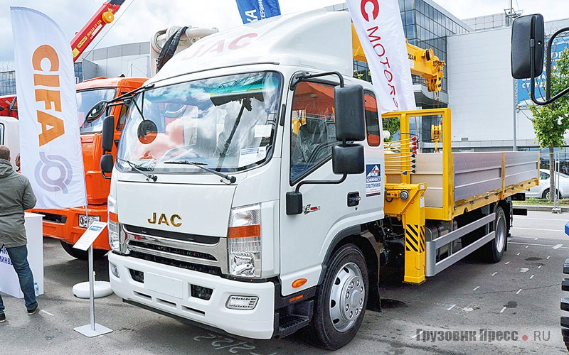 """Flatbed truck """"Rustrak-538948"""" with CMU Soosan SCS514 on JAC chassis N120 exhibited at the outdoor exhibition"""